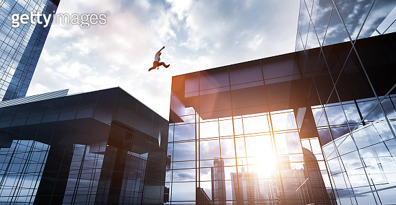 Man jumping between skyscrapers. Business success