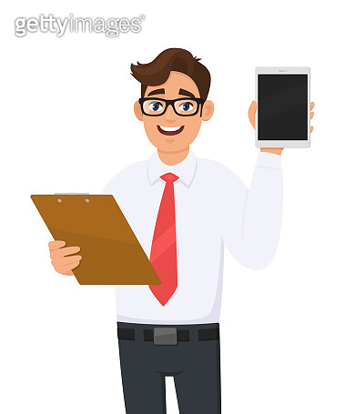 Young business man in eye glasses holding clipboard and showing tablet computer screen. Trendy person carrying document, file, checklist. Male character keeping folder. Cartoon illustration in vector.