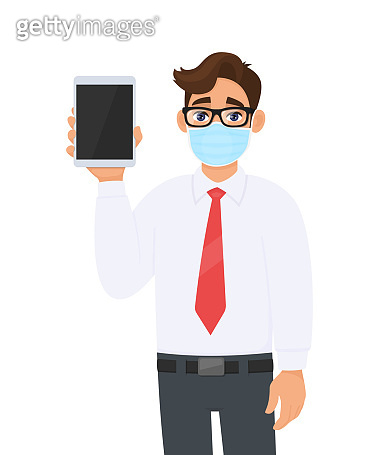 Young businessman wearing medical mask and showing tablet computer. Person with eye glasses holding digital pad. Healthy lifestyle and technology. Male character design illustration in vector cartoon.