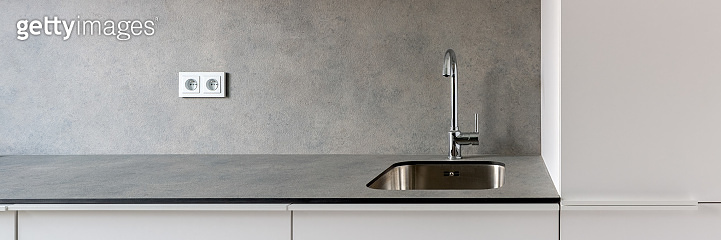 Simple kitchen sink in gray countertop, panorama