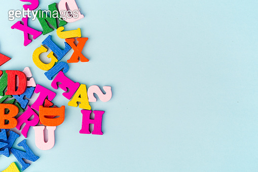 English letters on blue background composed from colorful abc alphabet leter. Back to school concept or Learning english or other language courses