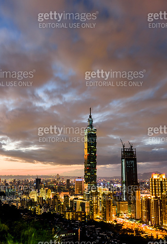 Panoramic cityscape of Taipei skyline and Taipei 101 Skyscraper at sunset scene.