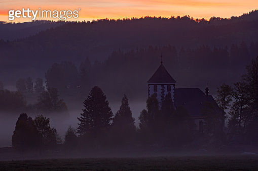 Morning in Zelnava village, Sumava, Czech Republic. Cold day in Sumava National park, hills and villages in the fog and rime, misty view on czech landscape, winter scene. Morning landscape with fog.