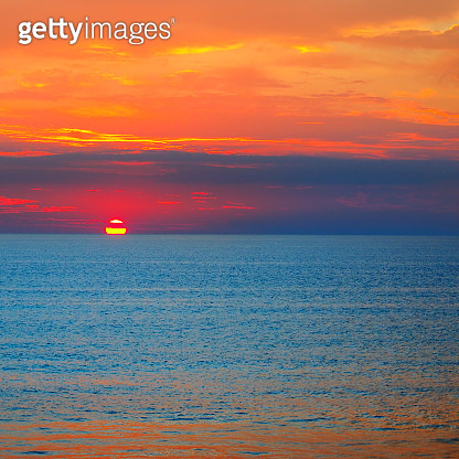 Beautiful cloudscape over the sea, sunrise shot. The concept is travel.