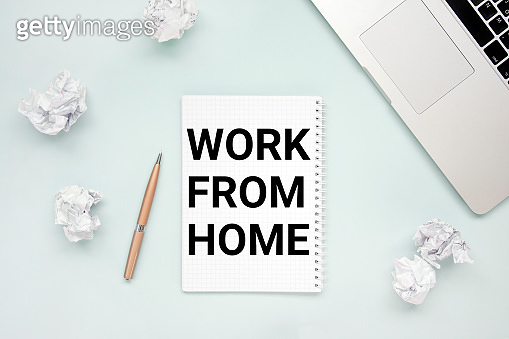 Work from home concept . Laptop, notepad, crumpled paper and pen top view flat lay photo with copyspace. Stay home to stop coronavirus