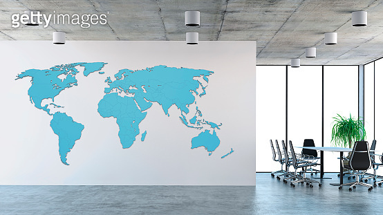 Empty office interior with conference table and world map