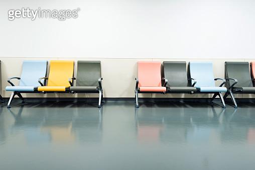 Colorful seats in hospital corridor