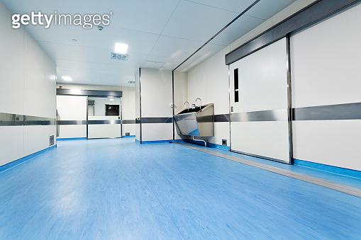 Stainless steel sink in hospital corridor