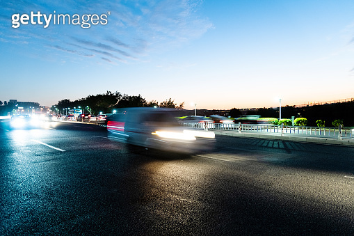 Cars driving on highway at dusk