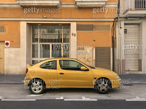 Yellow modern car parked in the street