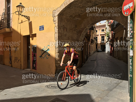 Riding bike in the historic center of Valencia, Spain