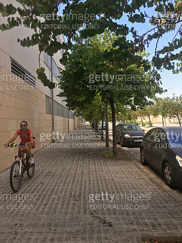 Young woman riding bike in the street