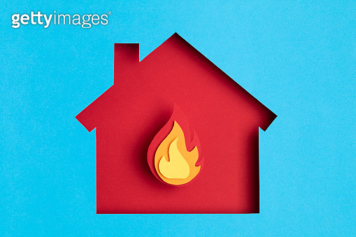 Papercut house with fire inside. Home insurance, security, safety, damage, accident prevention