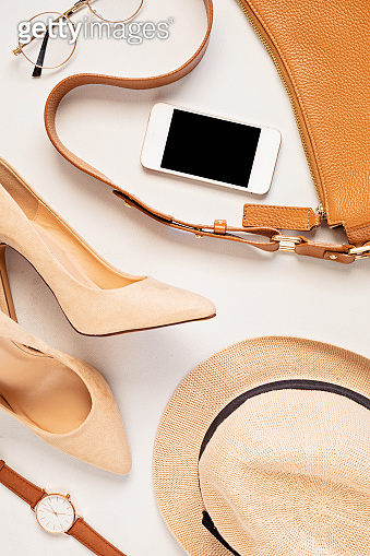 Flat lay with woman fashion accessories in neutral colors. Beauty blog, style, trends. Top view, copy space