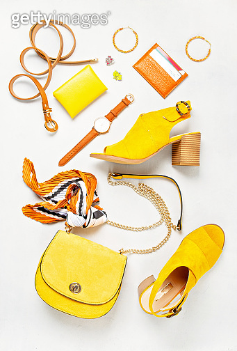 Flat lay with woman fashion accessories in yellow colors. Fashion blog, summer style, shopping and trends idea