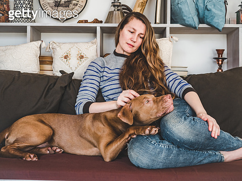 Stylish woman and pretty puppy. Close up