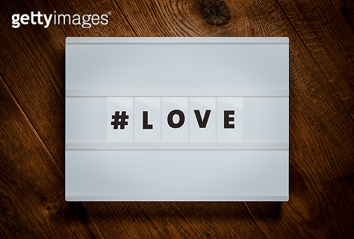 Message in white lightbox on wood