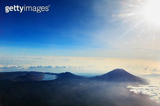 Aerial photo of Batur, Abang, Agung volcanoes on Bali island
