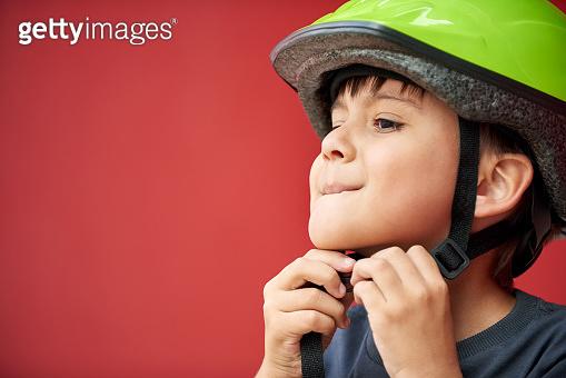 Fastening his helmet