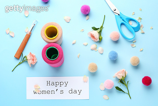 Greeting card for International Women's Day on color background