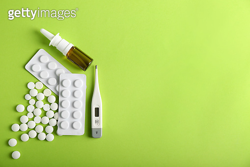 Items from first aid kit on color background