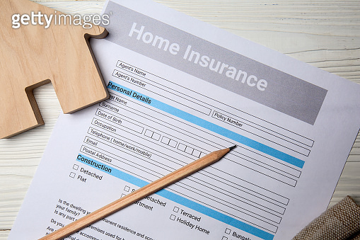 Home insurance form on white table