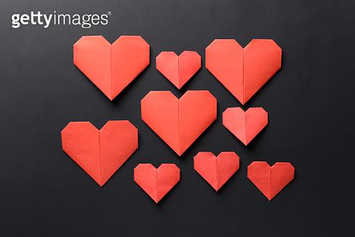 Origami hearts on dark background