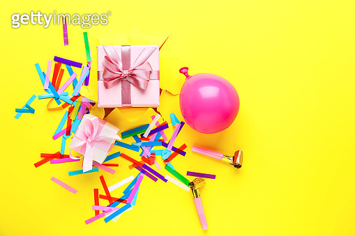 Beautiful gifts with party decor on color background