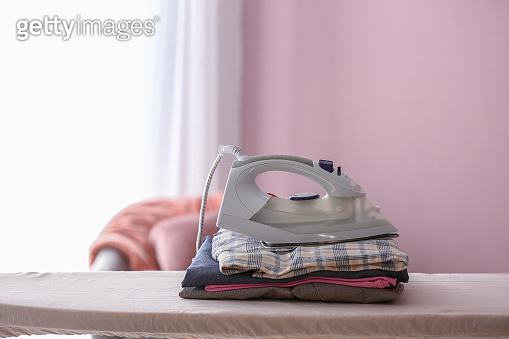 Iron with clean clothes on board