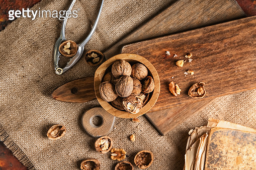 Bowl with tasty walnuts on table
