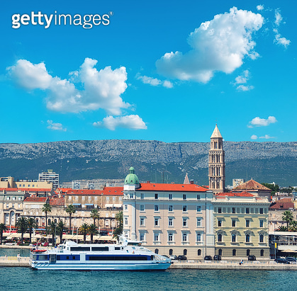 Architecture of Split harbor with Bell tower Saint Dominus and passenger ship. Split city, Dalmatia, Croatia.