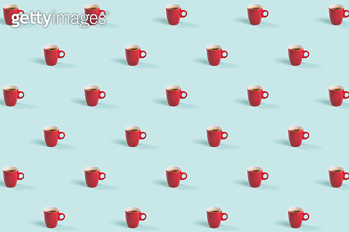 Red cup of coffee on blue background