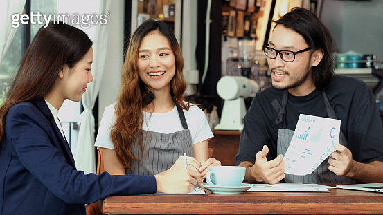 Young asian business woman discussing about financial planning with small business owner at cafe coffee shop, Business meeting corporate partnership, Asia financal loan for start up new business