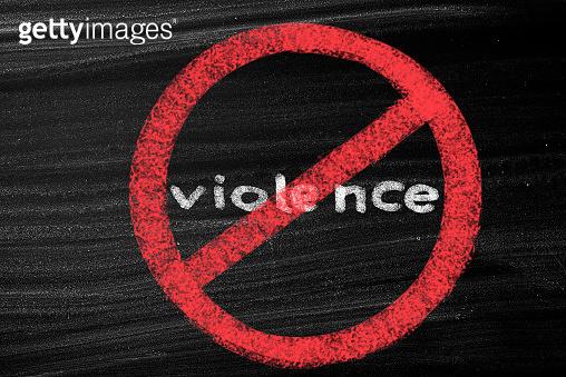 Violence written in a No Sign on blackboard