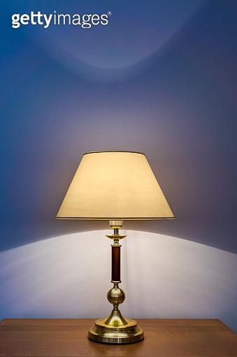 Table lamp near wall