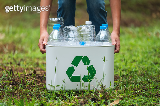 a recycle bin with plastic bottles in the outdoors