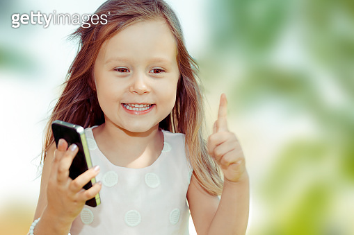 Kid with smartphone outdoors