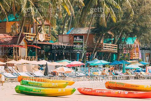 Canacona, Goa, India. Canoe Kayak For Rent Parked On Famous Palolem Beach In Summer Sunny Day