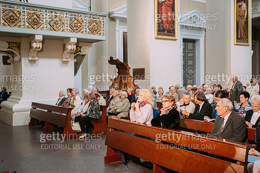 Vilnius, Lithuania. People Pray In Cathedral Basilica Of Saints Stanislaus And Vladislaus During Celebration Of Statehood Day. Holiday In Commemorate Coronation Of Mindaugas King