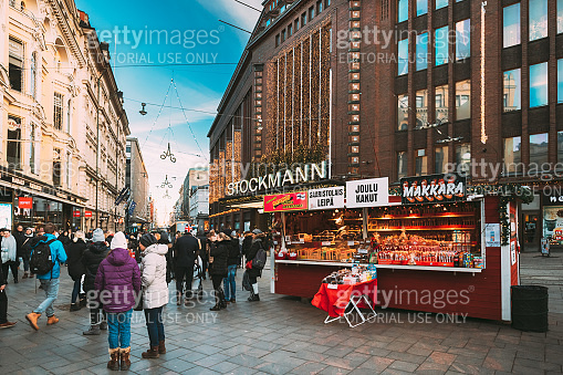 Helsinki, Finland. People Walking On Christmas Xmas Market Near Stockmann Department Store On Aleksanterinkatu Street At Winter Sunny Day