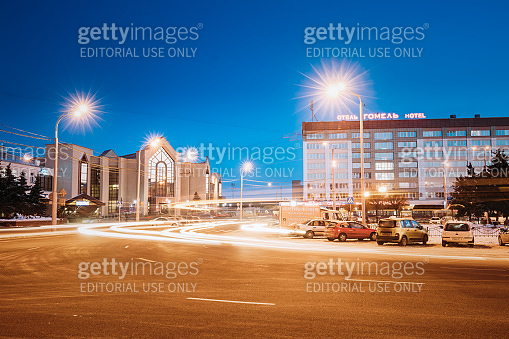 Gomel, Belarus. Railway Station Building And Hotel At Morning Or Evening. Train Station At Night Time In Winter Season