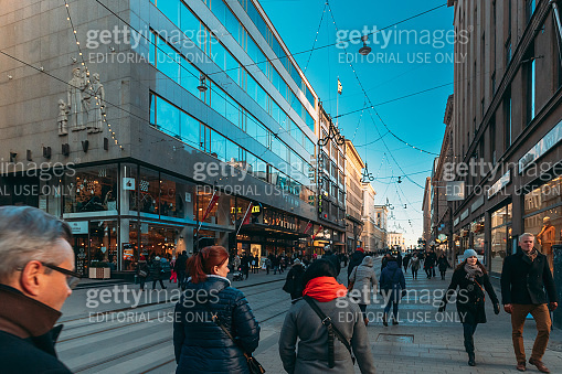 Helsinki, Finland. People Walking On Aleksanterinkatu Street In Winter Day. Street Decorated For Christmas And New Year Holidays