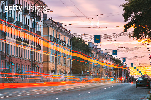 Gomel, Belarus. Traffic And Light Trails On Lenin Avenue In Eveining Or NIght. Street At Night At Long Exposure