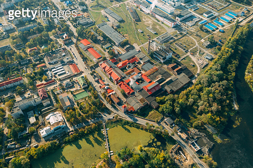 Dobrush, Gomel Region, Belarus. Aerial View Of Old And Modern Paper Factory. Historical Heritage In Bird's-eye View