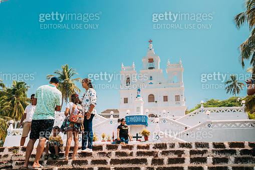 Panaji, Goa, India. People Walking Near Our Lady Of The Immaculate Conception Church Is Located In Panjim. Famous Landmark And Historical Heritage. Popular Destination Scenic