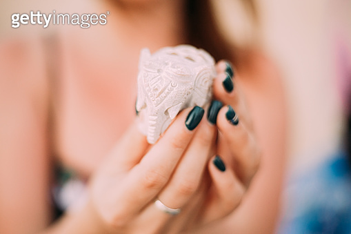 Goa, India. Elephants Souvenirs Of Stone In Woman's Hand