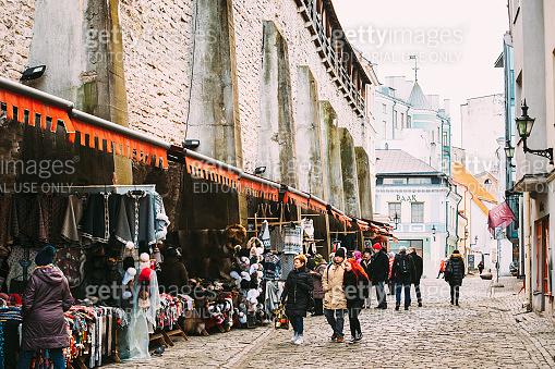Tallinn, Estonia. People Buyers In Visiting Street Market On Muurivahe Street At Winter Day