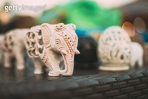 Goa, India. Elephants Souvenirs Of Stone On Shelf In Store. Goods For Tourists
