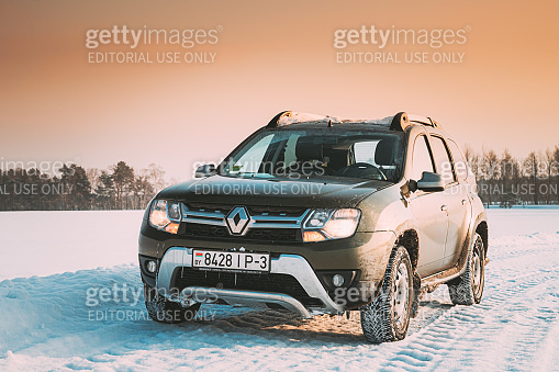 Gomel, Belarus. Car Renault Duster Or Dacia Duster Suv Parked On Winter Snowy Field Countryside Landscape. Duster Produced Jointly By French Manufacturer Renault And Its Romanian Subsidiary Dacia