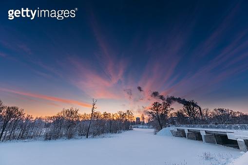 Dobrush, Gomel Region, Belarus. Old Paper Factory Tower In Winter Morning. Sun In Sunrise Over Historical Heritage